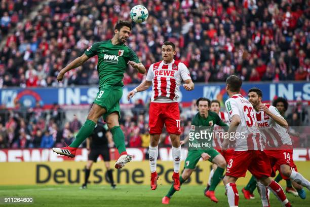 Rani Khedira of Augsburg jumps for a header with Christian Clemens of 1FC Koeln during the Bundesliga match between 1 FC Koeln and FC Augsburg at...