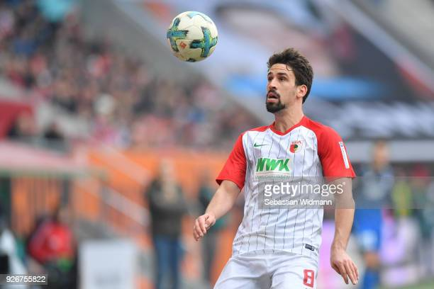 Rani Khedira of Augsburg plays the ball during the Bundesliga match between FC Augsburg and TSG 1899 Hoffenheim at WWKArena on March 3 2018 in...