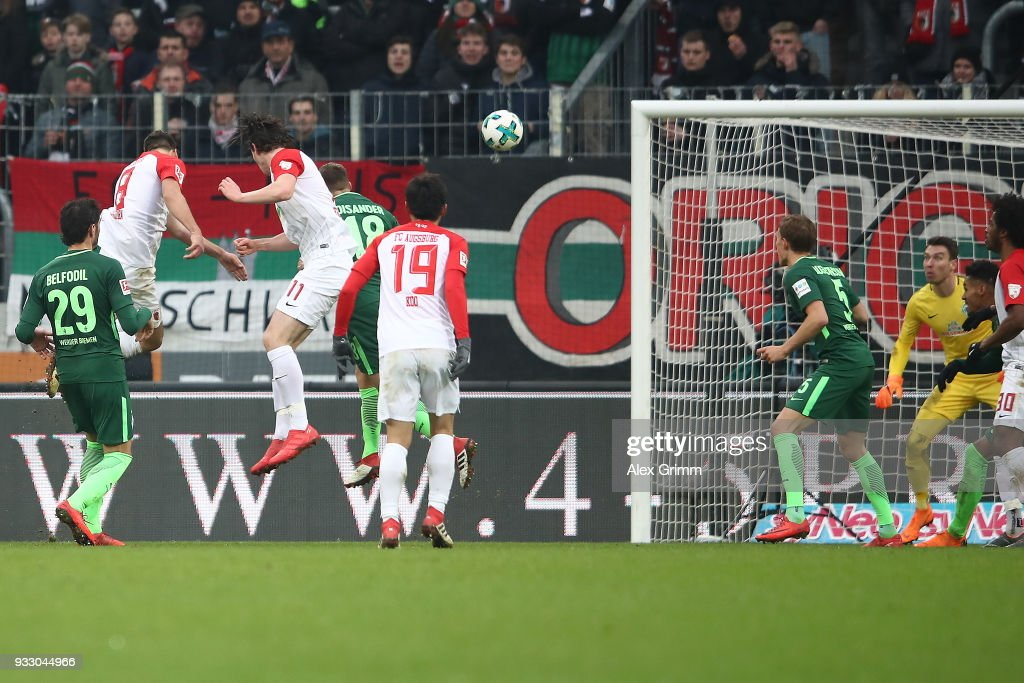 Rani Khedira of Augsburg (l) scores a head goal to make it 1:2 during the Bundesliga match between FC Augsburg and SV Werder Bremen at WWK-Arena on March 17, 2018 in Augsburg, Germany.