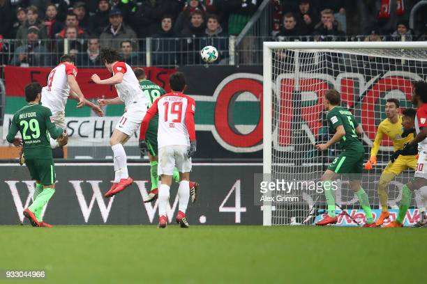 Rani Khedira of Augsburg scores a head goal to make it 12 during the Bundesliga match between FC Augsburg and SV Werder Bremen at WWKArena on March...