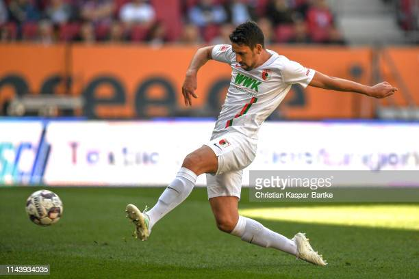 Rani Khedira of Augsburg scores his team's first goal during the Bundesliga match between FC Augsburg and VfB Stuttgart at WWKArena on April 20 2019...