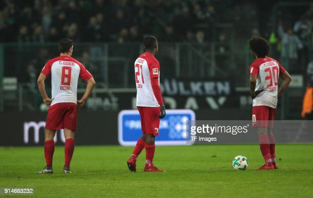 Rani Khedira of Augsburg Sergio Cordova of Augsburg and Caiuby of Augsburg look dejected during the Bundesliga match between Borussia...