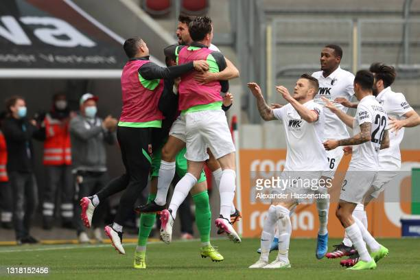 Rani Khedira of FC Augsburg celebrates with team mates after scoring their side's first goal during the Bundesliga match between FC Augsburg and SV...