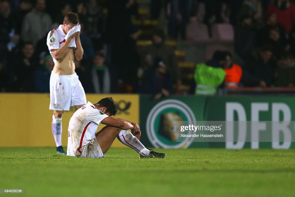 Rani Khedira (front) of Leipzig reacts with his team mate Marcel Halstenberg after the DFB Cup round two match between SpVgg Unterhaching and RB Leipzig at Alpenbauer Sportpark on October 27, 2015 in Unterhaching, Germany.
