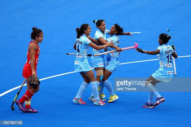 Rani of India celebrates scoreing her sides first goal with team mates during the FIH Womens Hockey World Cup Pool B game between India and the...