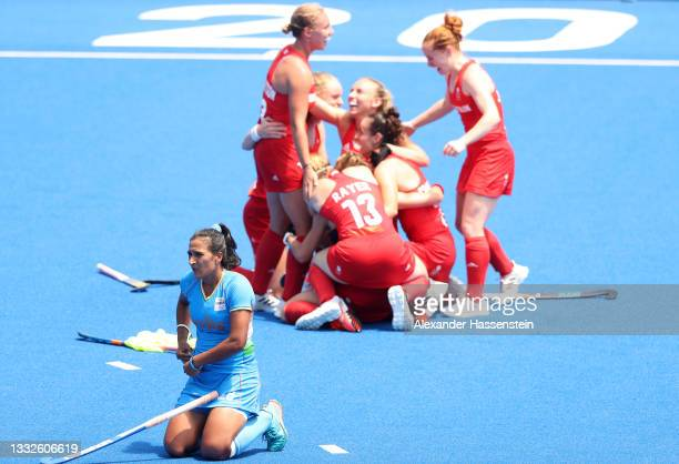 Rani of Team India looks on while Team Great Britain celebrates winning the Women's Bronze medal match between Great Britain and India on day...