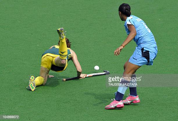 Rani Rampal from India dives for the ball with Casey Eastham from Australia during their field hockey match at the Major Dhyan Chand National Stadium...
