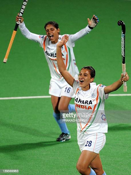 Rani Rampal of India celebrates with teammate Vandana Katariya after scoring a goal during their women's field hockey match against Canada of the FIH...