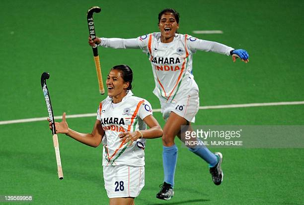 Rani Rampal of India celebrates with teammates after scoring a goal during their women's field hockey match against Canada of the FIH London 2012...