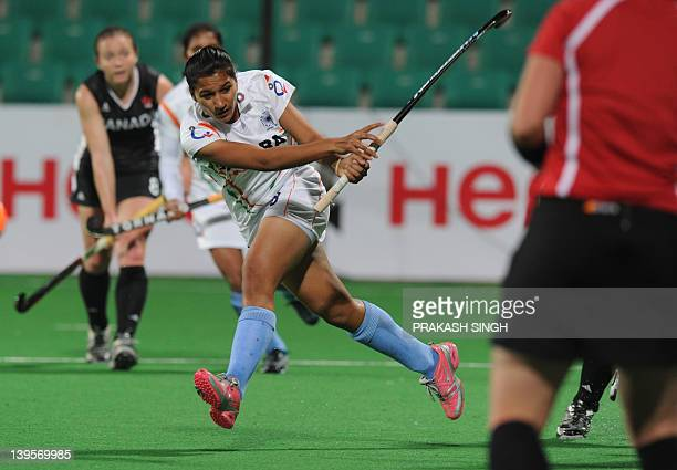 Rani Rampal of India plays a shot during their women's field hockey match against Canada of the FIH London 2012 Olympic Hockey qualifying tournament...