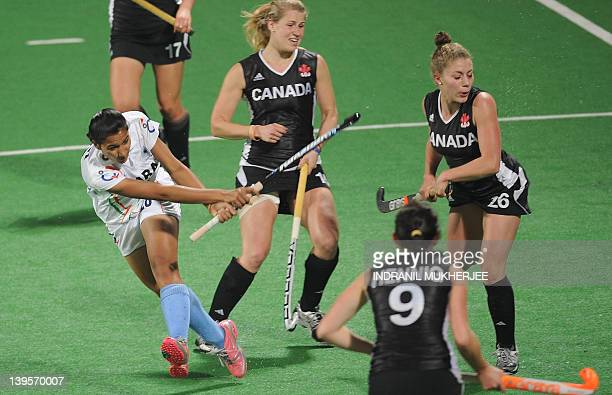 Rani Rampal of India scores a goal during their women's field hockey match against Canada of the FIH London 2012 Olympic Hockey qualifying tournament...
