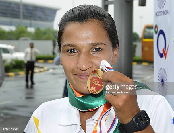 Rani Rampal star player of Indian Women's Junior Hockey team which won bronze medal at Junior Hockey World Cup showing her bronze medal after arrival...