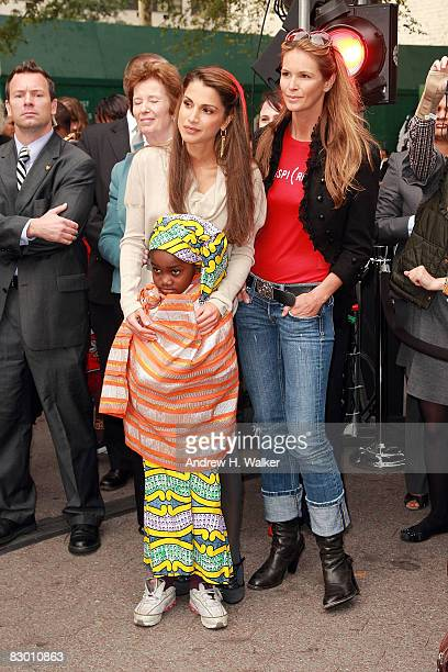 Rania Al Abdullah Queen of Jordan listens to Elle Macpherson attend the launch of the In My Name global campaign at Dag Hammarskjold Plaza on...