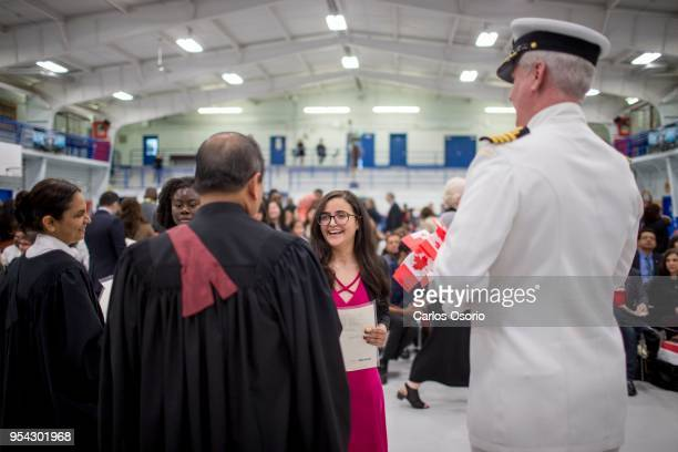 Rania Faidi originally from Iran receives a certificate during a citizenship ceremony held at the Royal Canadian Navy local reserve division HMCS...