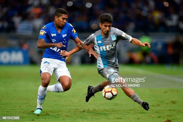 Raniel of Brazil's Cruzeiro vies for the ball with Alexis Soto of Argentina's Racing Club during their Copa Libertadores football match at the...
