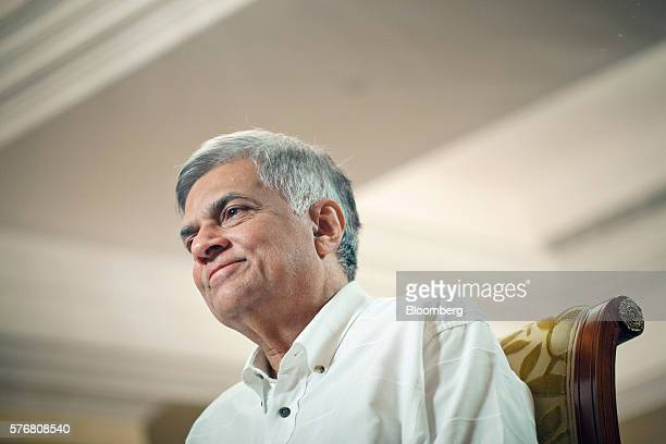 Ranil Wickremesinghe, Sri Lanka's prime minister, listens during an interview in Singapore, on Sunday, July 17, 2016. Sri Lanka is agnostic about...