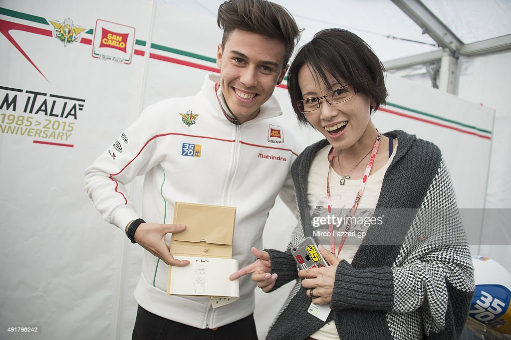 Ranka Fujiwara; of Japan (Illustrator) and Manule Pagliani of Italy and San Carlo Team Italia pose in box during the MotoGP Of Japan - Previews at Twin Ring Motegi on October 8, 2015 in Motegi, Japan.