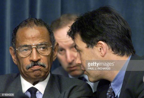 Ranking House of Representatives Judiciary Committee minority member John Conyers listens to the Democrat Counsel Julian Epstein at the start of the...