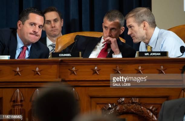 Ranking Member Devin Nunes Republican of California speaks with Representative Jim Jordan Republican of Ohio and Republican Counsel Stephen Castor...