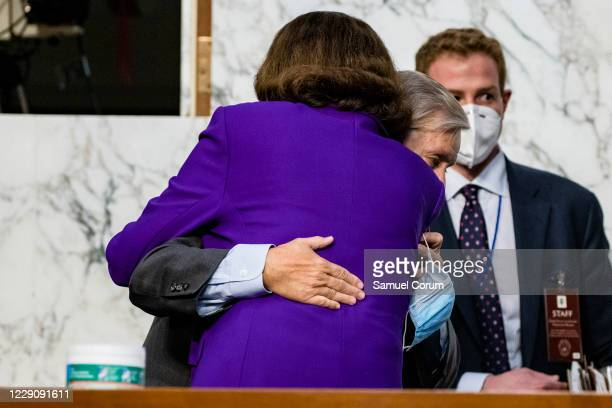 Ranking Member Dianne Feinstein and Chairman Lindsey Graham hug as the confirmation hearings for Supreme Court nominee Judge Amy Coney Barrett come...