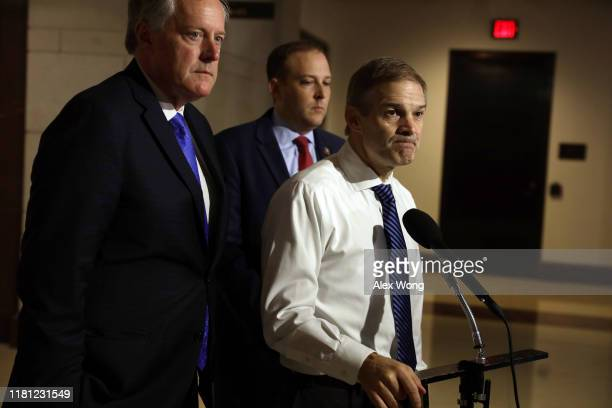 Ranking member of House Oversight and Reform Committee Rep Jim Jordan speaks to members of the media as Rep Mark Meadows and Rep Lee Zeldin listen...
