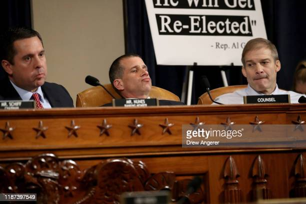 Ranking member of the House Intelligence Committee Devin Nunes minority counsel Steve Castor and Rep Jim Jordan listen to opening statements as top...