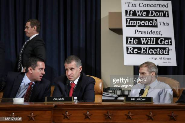 Ranking member of the House Intelligence Committee Rep Devin Nunes minority counsel Steve Castor and Rep Jim Jordan speak with each other as top US...