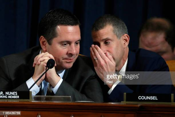 Ranking member of the House Intelligence Committee Rep Devin Nunes and minority counsel Steve Castor confer during a hearing before the House...