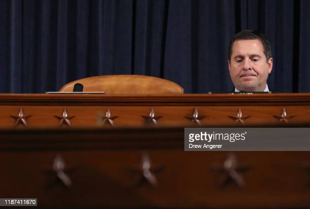 Ranking member of the House Intelligence Committee Rep Devin Nunes listens as top US diplomat to Ukraine William B Taylor Jr and Deputy Assistant...