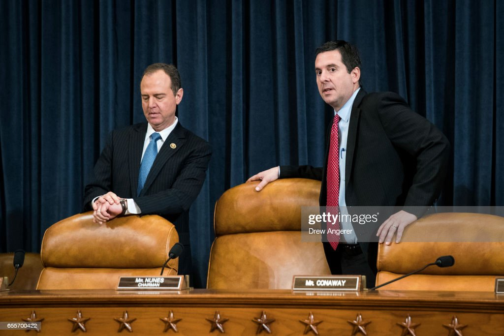 Ranking member Rep. Adam Schiff (D-CA) and chairman Rep. Devin Nunes (R-CA) prepare to take their seats after a break during a House Permanent Select Committee on Intelligence hearing concerning Russian meddling in the 2016 United States election, on Capitol Hill, March 20, 2017 in Washington. While both the Senate and House Intelligence committees have received private intelligence briefings in recent months, Monday's hearing is the first public hearing on alleged Russian attempts to interfere in the 2016 election.