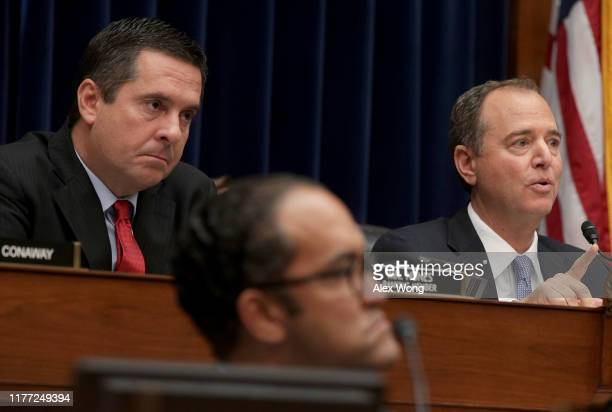 Ranking member Rep Devin Nunes and committee chairman Rep Adam Schiff listen as Acting Director of National Intelligence Joseph Maguire testifies...