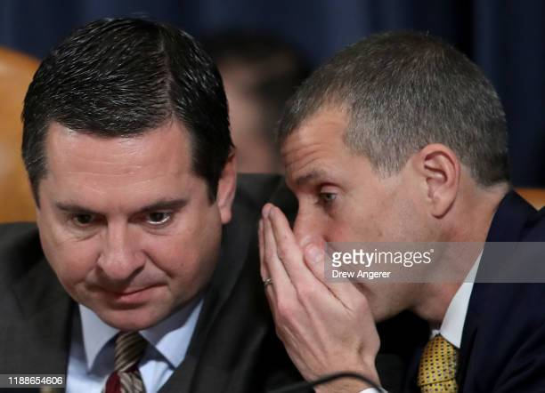 Ranking member Rep Devin Nunes confers with minority counsel Steve Castor as Lt Col Alexander Vindman National Security Council Director for European...