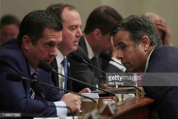 Ranking member Rep Devin Nunes listens to Rep John Ratcliffe during a hearing before the House Intelligence Committee June 12 2019 on Capitol Hill in...