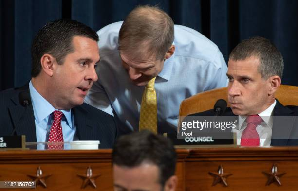 Ranking Member Rep Devin Nunes speaks with Rep Jim Jordan and Republican Counsel Steve Castor during the first public hearings held by the House...