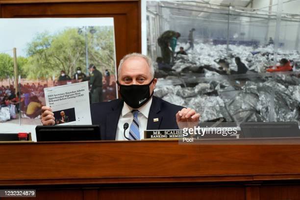 Ranking Member Rep. Steve Scalise holds up a copy of an article about immigrants during a House Select Subcommittee on the Coronavirus Crisis hearing...