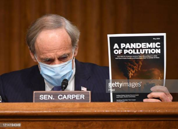 Ranking Member Sen. Thomas R. Carper holds up a magazine as he delivers opening remarks at a hearing titled Oversight of the Environmental Protection...