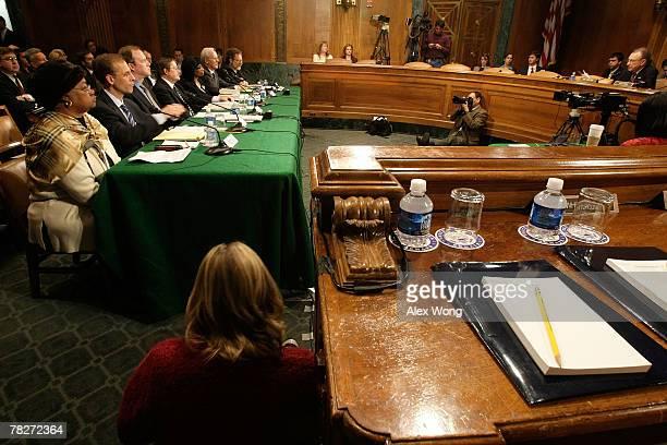 Ranking member US Sen Arlen Specter speaks as witnesses Homeowner Nettie McGee of Chicago Illinois Chief Economist of Moodys Economycom Inc Mark...