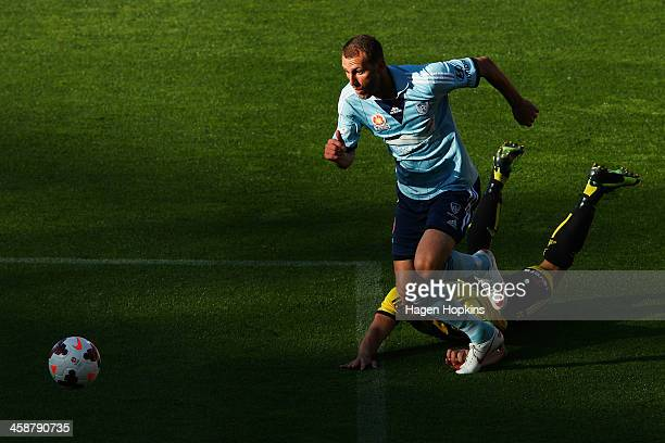 Ranko Despotovic of Sydney FC beats the defence of Andrew Durante of the Phoenix during the round 11 ALeague match between Wellington Phoenix and...