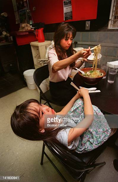 Ranko Houston fills a bowl of ramen for her daughter Jessica at Sapporo Ramen a noodle restaurant at Porter Square Exchange