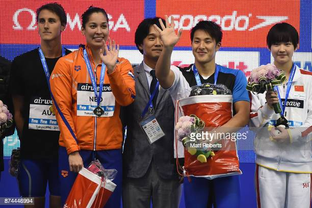 Ranomi Kromowidjojo of Netherlands and Daiya Seto of Japan pose for a photograph during the victory ceremony on day two of the FINA Swimming World...