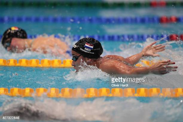 Ranomi Kromowidjojo of Netherlands compete in the Women's 100m butterfly final race during day two of the FINA Airweave Swimming World Cup Berlin...