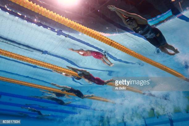 Ranomi Kromowidjojo of the Netherlands Pernille Blume of Denmark and Penny Oleksiak of Canada compete during the Women's 100m Freestyle semi final on...