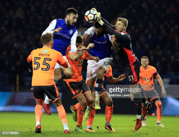 rAnssi Jaakkola of Reading clears from Atdhe Nuhiu of Sheffield Wednesday during The Emirates FA Cup Fourth Round match between Sheffield Wednesday...