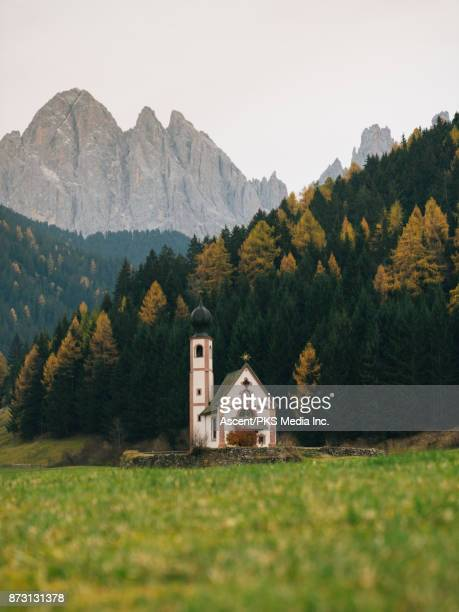 Ranui church below high rocky mountains in valley