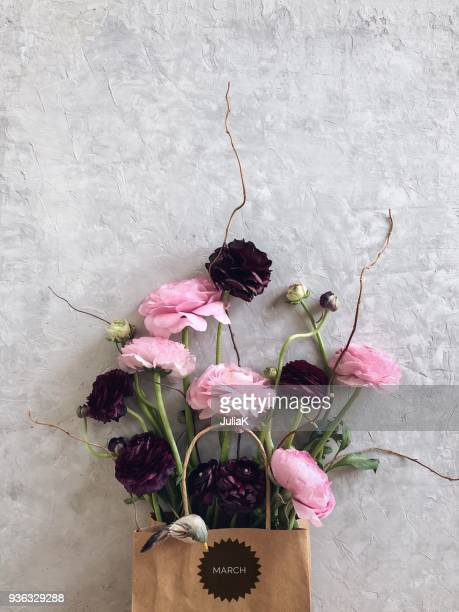 ranunculus flowers in a paper bag with a march sticker - fragile sticker stock pictures, royalty-free photos & images