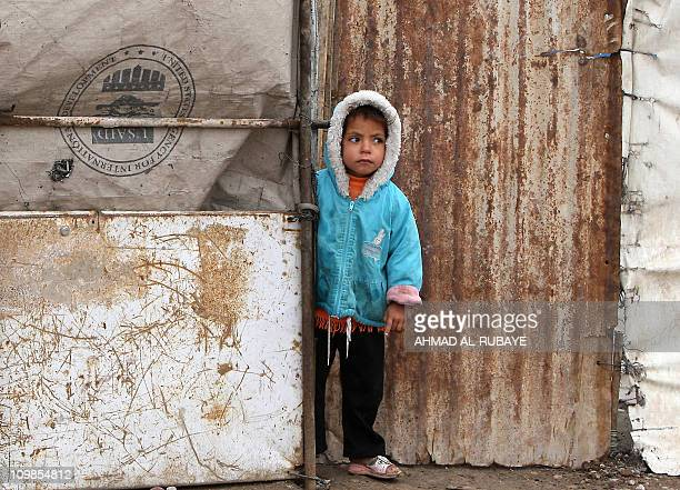 RAOAn Iraqi child stands at the entrance to a makeshift house at an old army camp in the Zaafaraniyah district of Baghdad on January 26 2011 More...