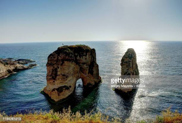 raouche or pigeon rock, beirut, lebanon - east stock pictures, royalty-free photos & images