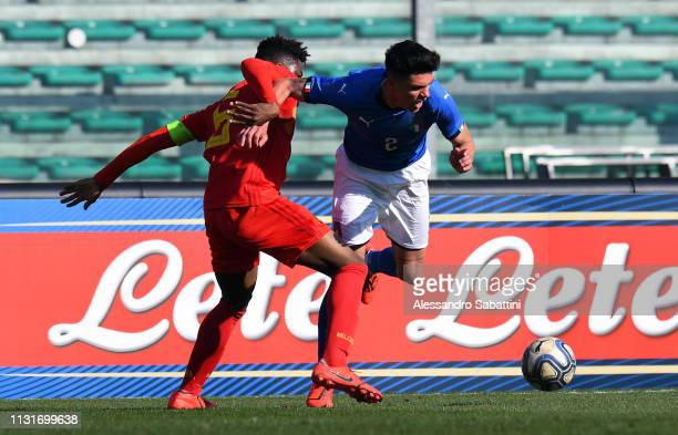 Raoul Bellanova of Italy U19 competes for the ball with Lucas Lissens of Belgium U19 during the UEFA Elite Round match between Italy U19 and Belgium...