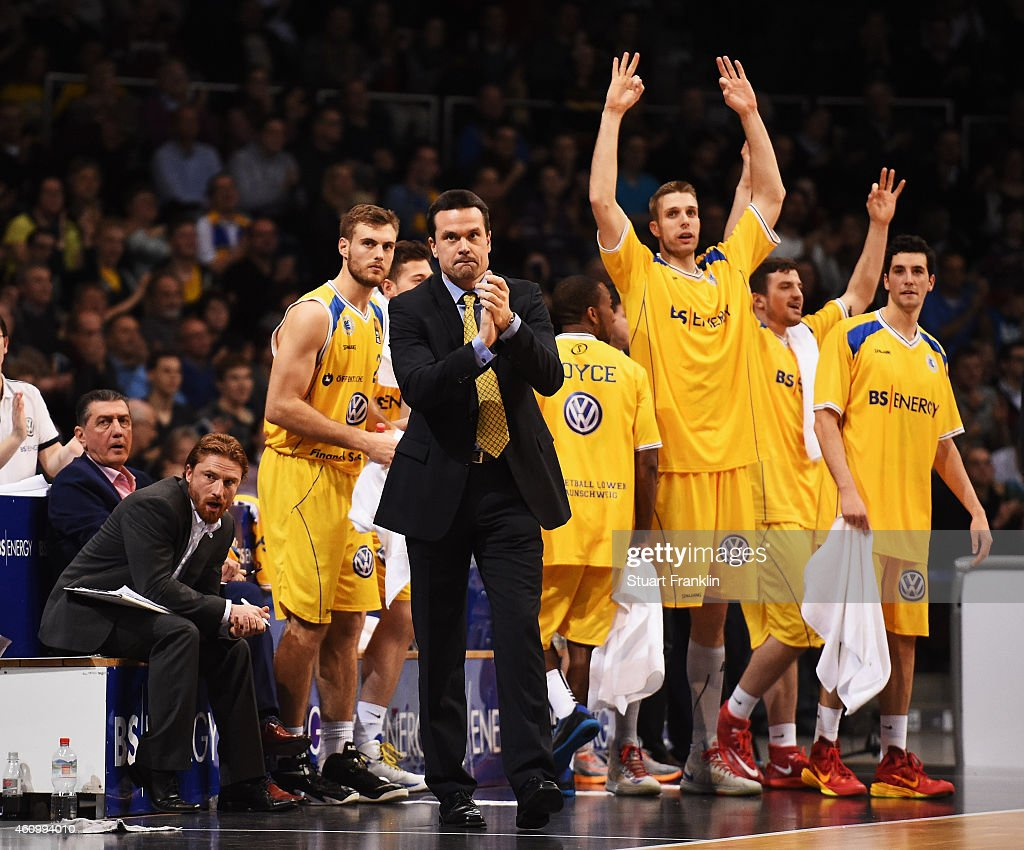 Raoul Korner, head coach of Braunschweig celebrates with his players during the Bundesliga basketball game between Basketball Loewen Braunschweig and Artland Dragons on January 3, 2015 in Braunschweig, Germany.