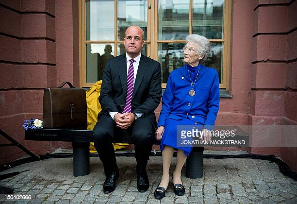 Raoul Wallenberg's sister Nina Lagergren and Swedish Prime Minister Fredrik Reinfeldt sit on the new memorial to Raoul Wallenberg outside the...